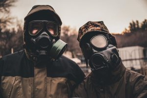 two people in gas masks
