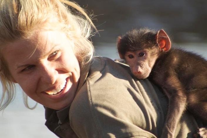 Volunteer World Mensch mit Affe