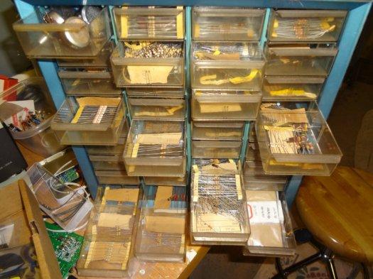 Component bins of assorted resistors.