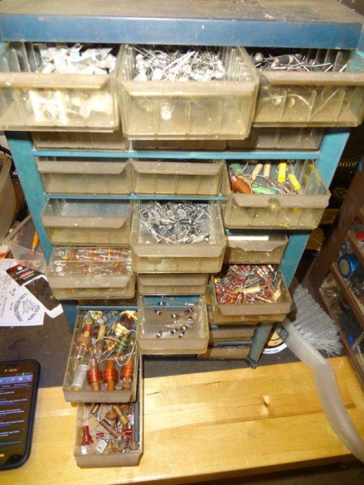 Component bins of resistors, capacitors, coils.
