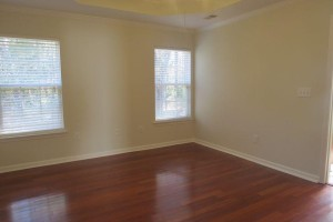 Master bedroom with hardwood floor