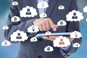 businessman using tablet with cloud icons - How Cloud Managed Services Can Propel Your Business: 8 Key Benefits