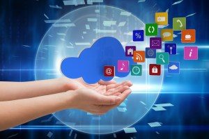 cloud image with icons flying out - composite of hand holding cloud graphics