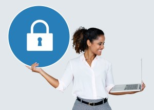 woman holding laptop and lock icon - VPN 101: Protecting Your Business Data on the Internet