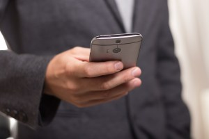 business man on his cellphone - Top 7 Reasons to Use a Managed Security Services Provider