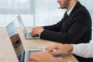 people working on laptop with headsets 300x200 - Stopping Threats Before They Happen: 4 Ways Cisco Umbrella Protects Your Business