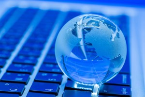 glass globe on laptop keybard - NIST SP 800-171 Is Now More Important Than Ever: Are You Following the Framework?