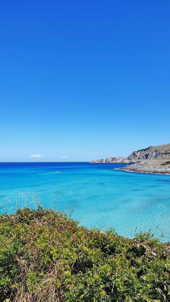 crystal clear waters of cala mesquida beach majorca