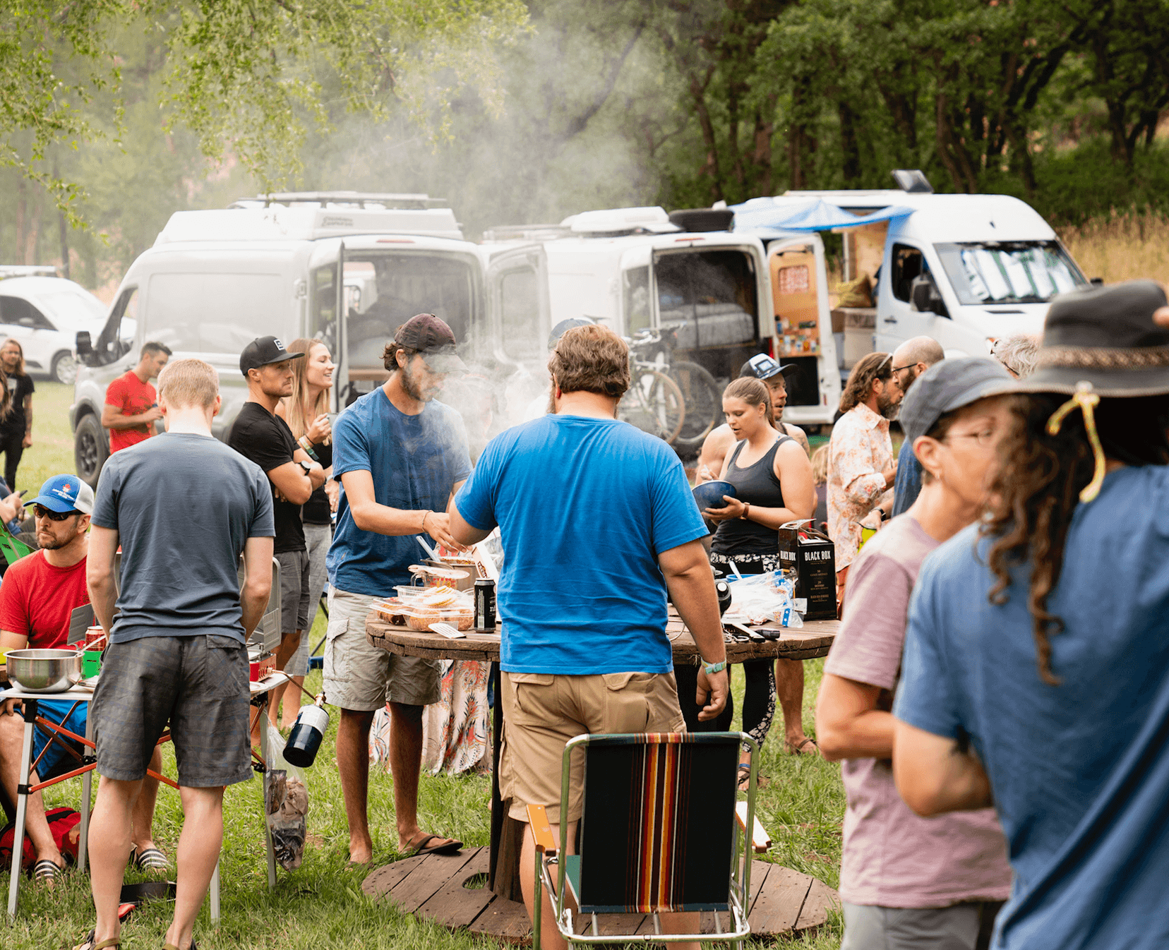 people eating barbecue at camper van event potluck