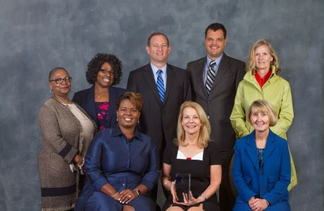 Daily Planet Health Services team with award