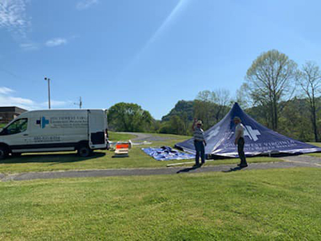 Southwest Virginia Community Health Systems staff setting up tent for COVID-19 drive thru testing event