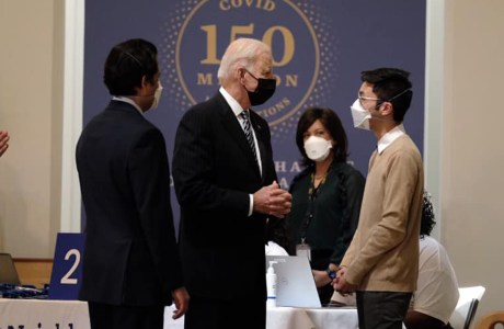 President Biden talking to Neighborhood Health staff at a vaccination clinic