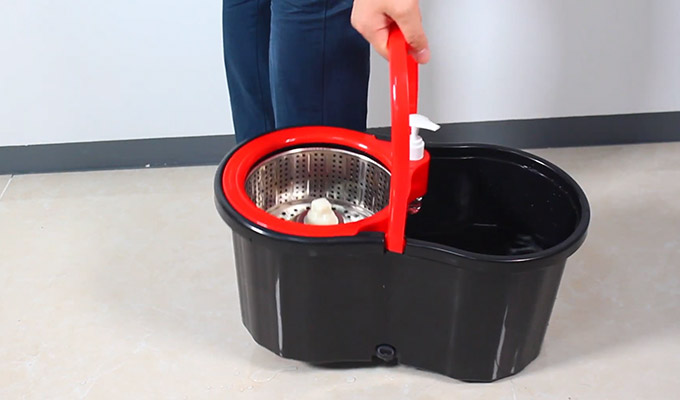 Using Spin Mop and Bucket System