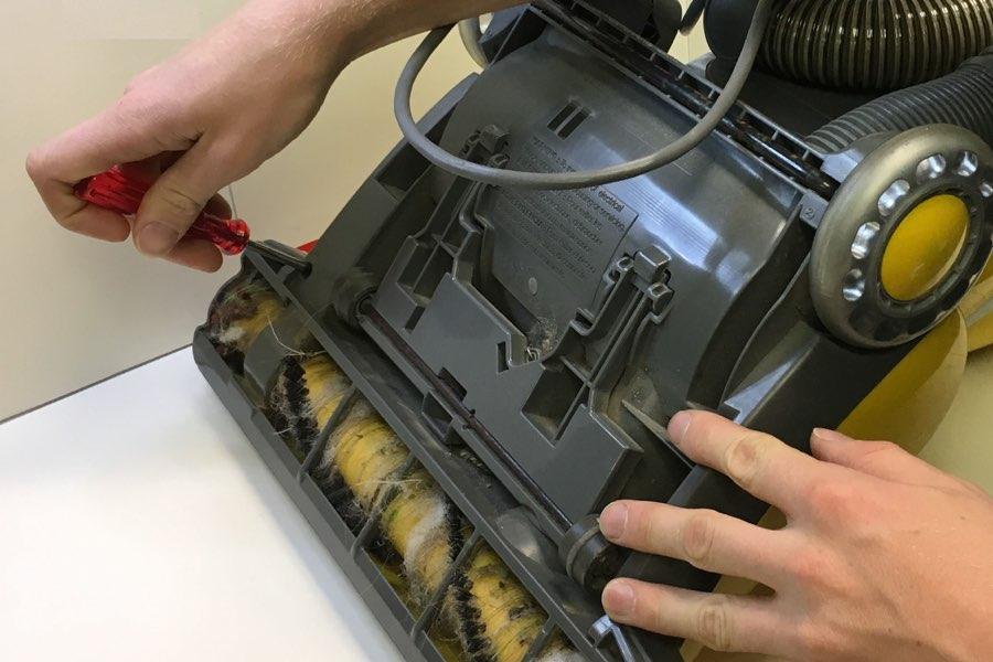 Centennial Vacuum technician repairing a vacuum