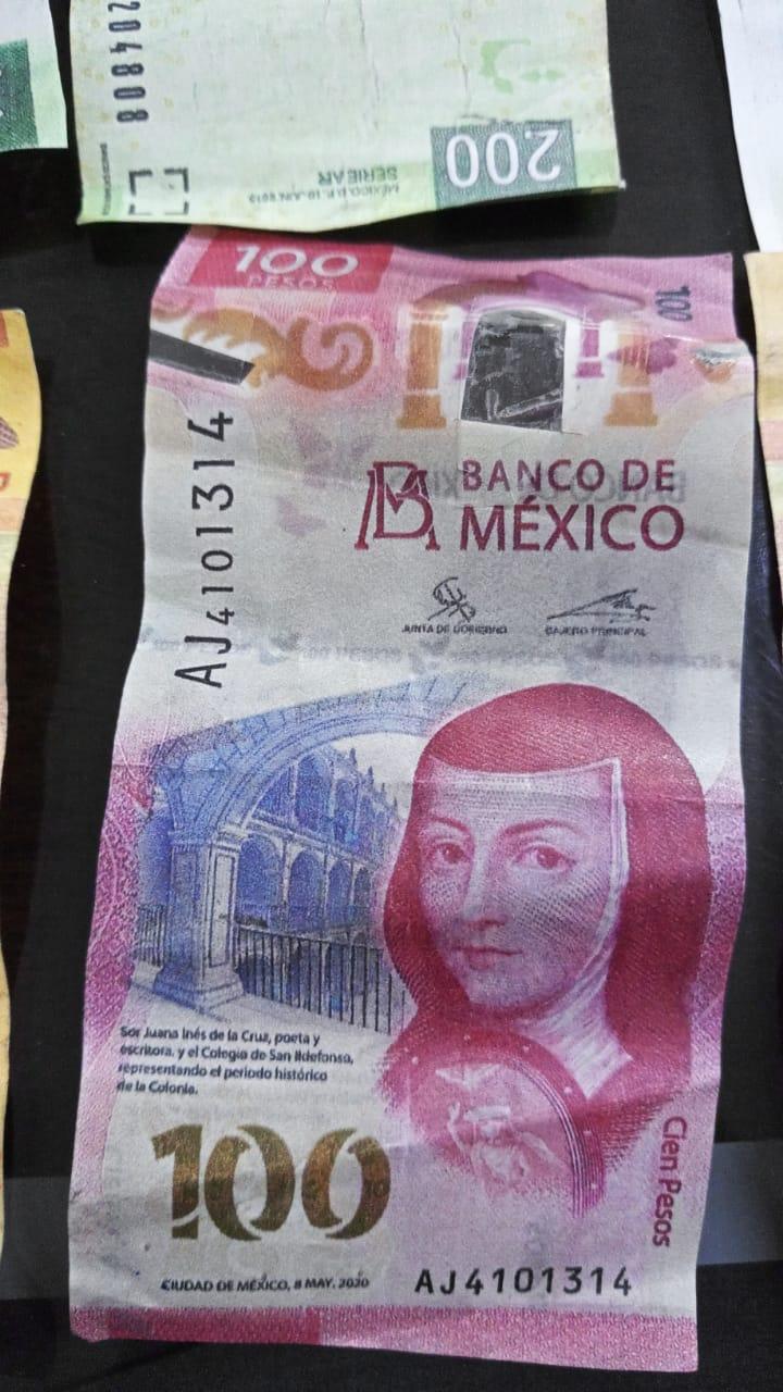 Detienen en Tecomán a pareja de falsificadores de billetes