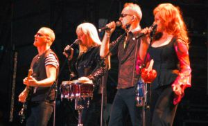 photo of the B-52s, on stage and in concert, live