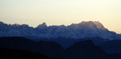 First rays of morning sun on Chaukhamba Peak, as seen from Badshah Thaul