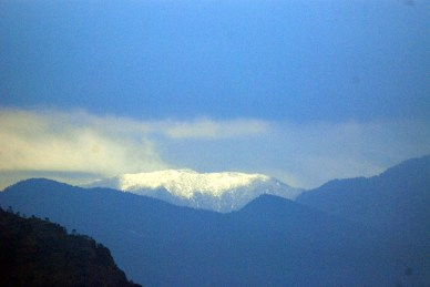 Mountains bask in glory of a fresh snowfall.