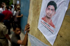 A placard showing a portrait of a missing pilgrim is seen on a wall at the Jolly Grant Airport in Dehradun, state capital of Uttarakhand. After all stranded ones are rescued, a franatic search for missing ones will start.