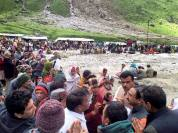 Former Uttarakhand Chief Minister Ramesh Pokhariyal interacting with pilgrims near flood-hit Kedarnath shrine in Rudraprayag on Thursday.