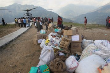 Indian Air Force personnel unloading relief material from a chopper during their flood relief operations at Guptakashi near Kedarnath in Uttrakhand on Thursday.