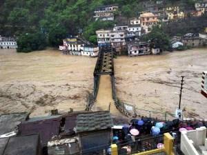 Rudraprayag: A view of a submerged bridge over river Ganga in Rudraprayag, Uttarakhand on Tuesday following incessant rains.