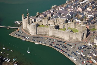 Aerial view of the Caernarfon Castle in Gwynedd, north-east Wales. It is one of the most important historic sites of Wales. Photo: Visit Wales