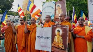 Buddhist Monks take part in a silent protest against serial explosions at Bodhgaya, in Kolkata on Sunday.