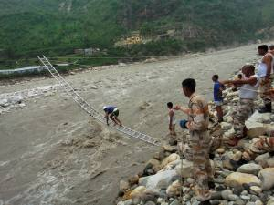 ITBP personnel rescuing flood victims with the help of rope and ladder in Uttarkashi