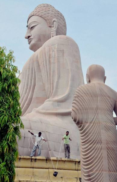 Bomb defusal personnel recover a cane bomb,  near the statue of Lord Buddha at World Heritage Mahabodhi Temple in Bodhgaya on Sunday