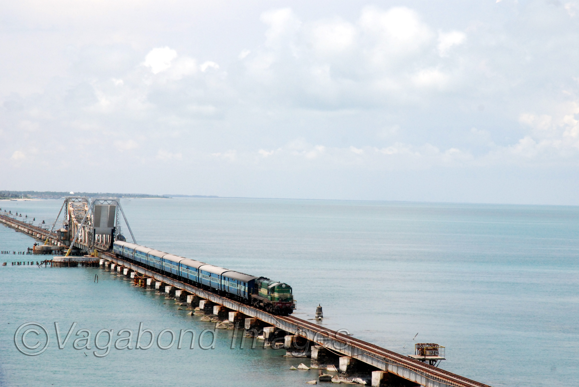 Train from Madurai crossing the bridge to enter the Pamban island