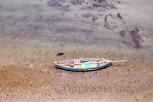 A boat anchored just below the bridge