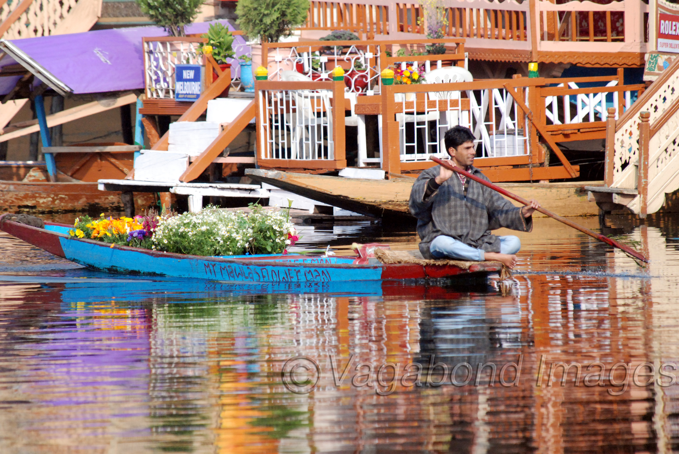A shikara loaded with beautifully arranged flowers is one of the mostly anticipated sights in a Dal morning