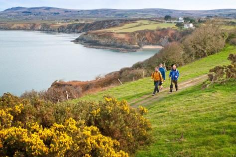 Walkers on Coast Path near Cwm-yr-Eglwys Pembrokeshire