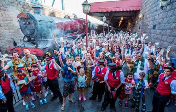 Cheers from guests filled the air at Hogsmeade Station today as Universal Orlando Resort celebrated its one millionth rider on the Hogwarts Express – the iconic train that transported Harry Potter and his friends between Hogsmeade Station and King's Cross Station in J.K. Rowling's beloved series. To celebrate this magical milestone, nearly two hundred guests were given complimentary Butterbeer ice-cream. In early July, guests began boarding the Hogwarts Express to travel between The Wizarding World of Harry Potter – Hogsmeade in Universal's Islands of Adventure and The Wizarding World of Harry Potter – Diagon Alley in Universal Studios Florida. The incredible journey, which requires a park-to-park ticket, combines powerful storytelling, live special effects, lifelike animation and state-of-the-art technology to take riders on the journey of a lifetime. © 2014 Universal Orlando Resort. All rights reserved. HARRY POTTER, characters, names and related indicia are trademarks of and © Warner Bros. Entertainment Inc. Harry Potter Publishing Rights © JKR.