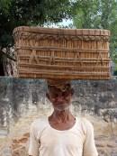 Carrying a huge burden still on his head!