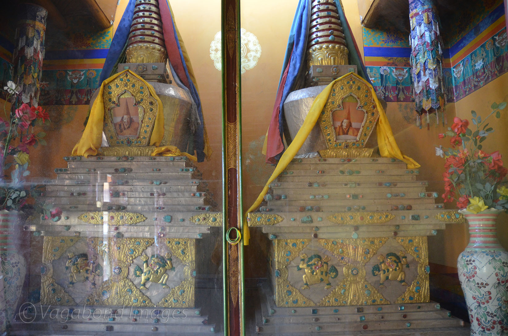 Silver and golden prayer wheels