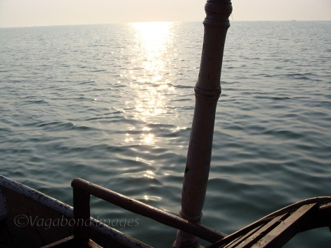 A early morning boating on a local boat in Chilika lake.