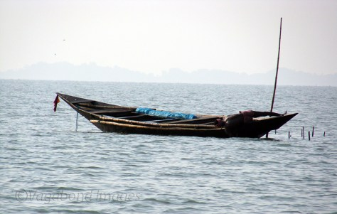 A fisherman adjusting his net