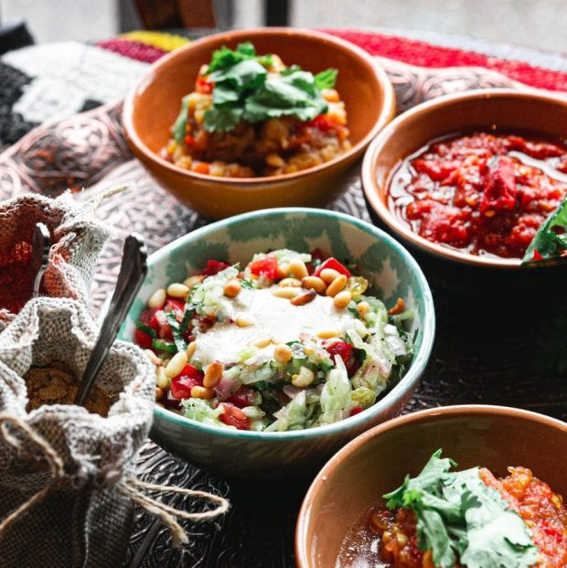 traditional Mediterranean dishes served on copper tray
