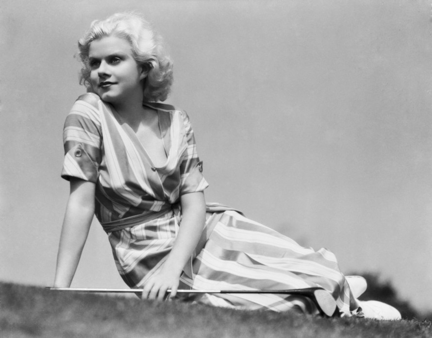 1932: Actress Jean Harlow (1911 - 1937) takes a breather between greens on the golf course dressed in a striped summer dress. (Photo by Clarence Sinclair Bull)