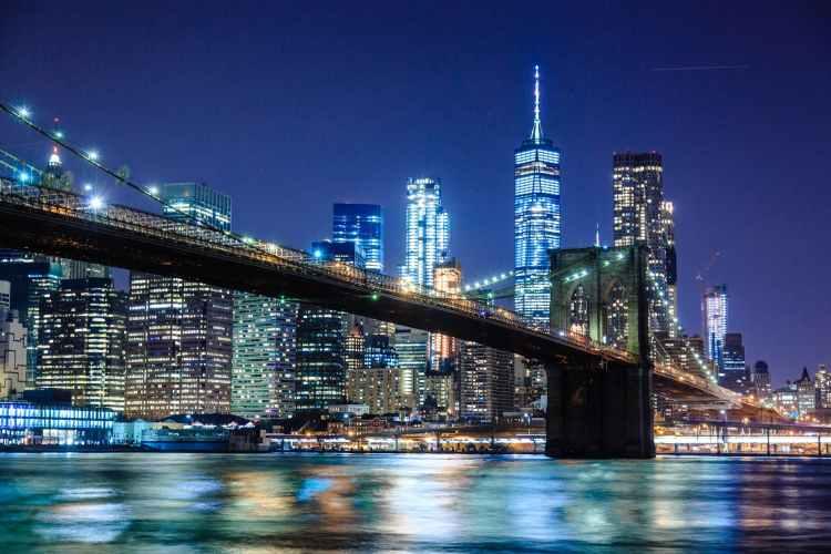 photography of bridge during nighttime