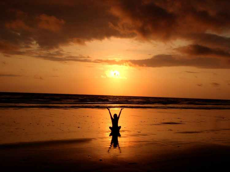 silhouette of person raising its hand