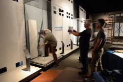 Mount-makers install the first of more than 500 artifacts in The Story of Virginia.