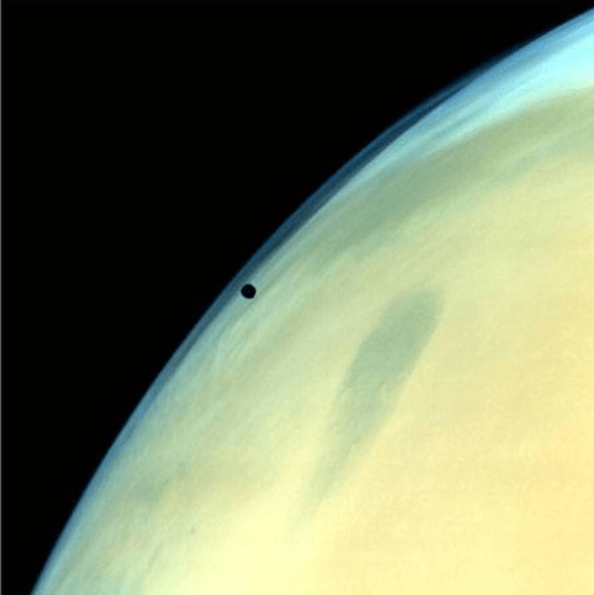 Phobos, one of the two natural satellites of Mars silhouetted against the Martian surface (courtesy Isro)
