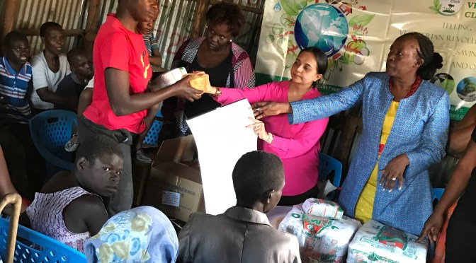 Reaching out to women and handicapped children in slums during christmas