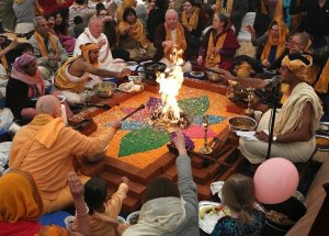 Members of the Hare Krishna congregation take part in a holy Hindu ritual called Yajna at the Bhaktivedanta Manor Krishna temple (PA)