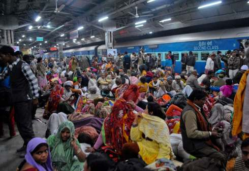 Passengers crowd together at a platform after part of a railing from a bridge collapsed at Allahabad railway station