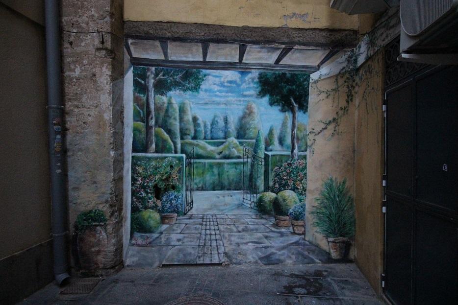 Pintura mural Shabby Chic Vintage Market en la plaça del Miracle del Mocadoret