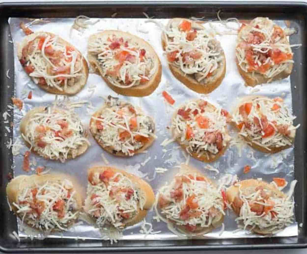 How to assemble Alfredo canapes recipe with Alfredo mixture, cheese and tomatoes.
